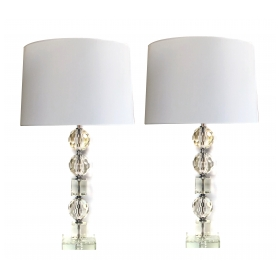 a shimmering and large-scaled pair of french mid-century stacked faceted crystal lamps