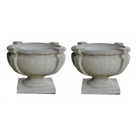 a handsome pair of cast stone garden urns