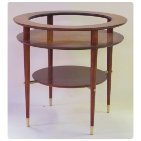 stylish and sleek italian mid-century circular side table with glass top and brass fittings