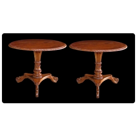 handsome and warmly-patinated pair of Swedish circular tilt-top tripod pedestal tables