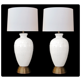 a boldy-scaled pair of american 1960's white crater-glazed ovoid-form ceramic lamps