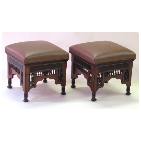 a well-carved pair of moroccan square stools with ebonized highlights