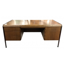 a sculptural and sleek american 1970's oak executive desk with steel supports; by Norman Bates, Inc; Anaheim, CA