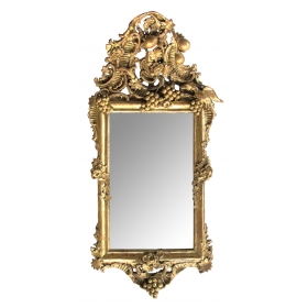 an ornately carved french rococo gilt-wood mirror with exuberant crest