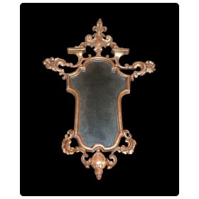 a finely carved french napoleon iii  giltwood cartouche-shaped mirror