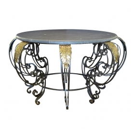 a curvaceous french rococo style wrought-iron circular center table with gray marble top