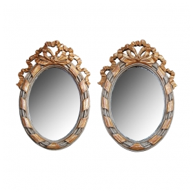 a charming pair of french rococo style gray painted and parcel-gilt carved wood oval wall mirrors