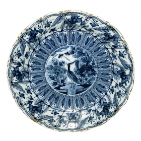 a boldly-scaled dutch delft blue and white charger with lobed rim