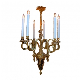 a curvaceous french louis xv style gilt-bronze 6-light chandelier with dramatically scrolling candlearms