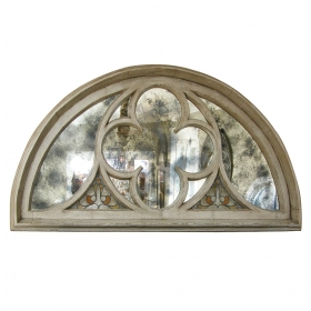 a massive french neogothic gray painted carved wood arched window frame inset with antique mirror plates