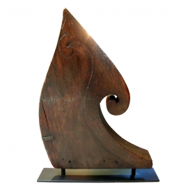 a tall and curvaceous south indian (kerala) carved teak boat prow with curling volute and incised decoration