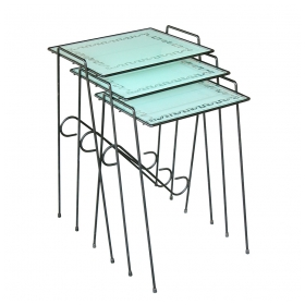 a stylish set of three american 1950's wrought iron nesting Tabless with frosted glass tops