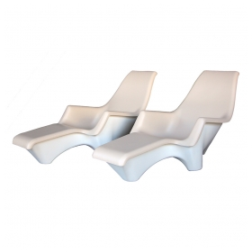 a stylish and sculpted pair of american 1960's fiberglass outdoor lounge Chairss