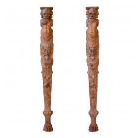 a stately and well-carved pair of continental wooden architectural elements
