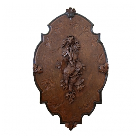 a german black forest carved walnut applique of hunting trophies