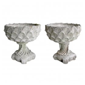a large and unique pair of italian cast stone garden urns in the 'Grotto' taste