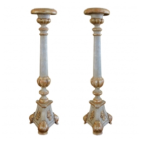 a large-scaled pair of italian neoclassical pale green painted and parcel-gilt carved candlesticks