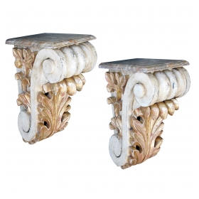 a dramatic and large-scaled pair of american classical-revival ivory painted and parcel-gilt carved wooden corbels or brackets