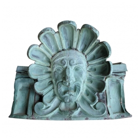 a dramatic and large-scaled american beaux-arts verdigris copper architectural element of a sun god; removed from the commodore hotel, grand central station, new york city