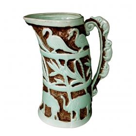"an exotic english 1940's polychromed pottery ewer with elephant handle; marked ""burleigh ware, burslem, england"""