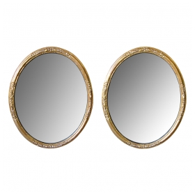 an elegant pair of french napoleon III carved giltwood oval mirrors