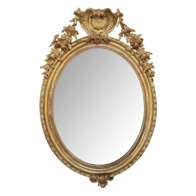 a finely-carved french napoleon III oval giltwood mirror with shell crest and floral garland