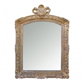 an elegant french regence carved giltwood mirror with plumed crest
