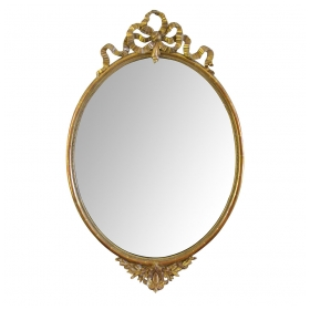 an elegant french napoleon III oval giltwood mirror with exuberant ribbon crest