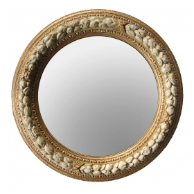 a well-carved english georgian style ivory painted and parcel-gilt circular mirror