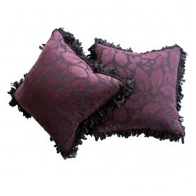 a sumptuous pair of aubergine cut velvet pillows with silk ribbon fringe