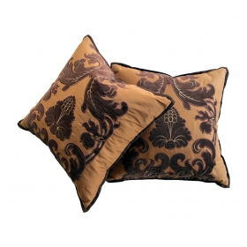 a sumptuous pair of Bergamo russet-colored silk pillows with chocolate brown velvet medallion and scrollwork