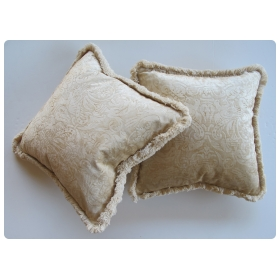 a sumptuous pair of ivory cut-velvet silk pillows with cotton fringe