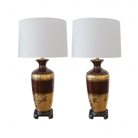 a richly-colored pair of american 1960's chocolate-brown ceramic lamps with fine gilt decoration