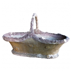 an unusually large french faux bois concrete basket-form jardinière with arching handle