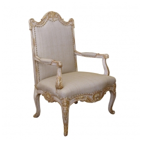 a baronial and well-carved french regence style ivory painted and parcel-gilt open armChairs