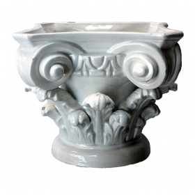 a handsome italian white-glazed faience corinthian capital