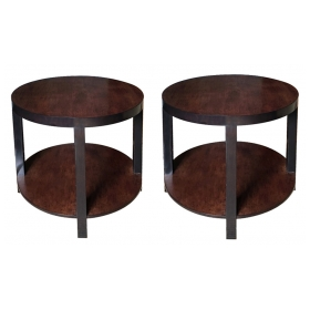 a pair of mid-century mahogany circular side tables with ebonized highlights; in the manner of robsjohn-gibbings
