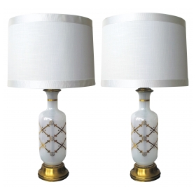 a subtly-translucent pair of american white opaque glass bottle-form lamps with gilt decoration