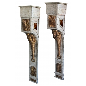 a tall and richly-carved pair of french napoleon III ivory painted and parcel-gilt wall brackets
