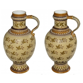 a good quality pair of german mettlach pottery ewers; each with impressed maker's mark; dated 1893