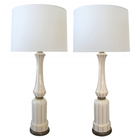 a tall and striking pair of american 1960's ivory porcelain baluster-form lamps with gilt striping; by Lenox