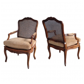 an elegant pair of french rococo beechwood open arm Chairss with caned seat and back
