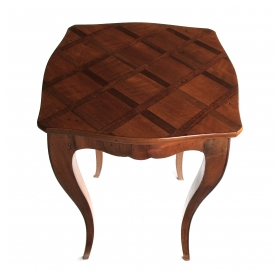 a graceful and warmly-patinated italian rococo style fruitwood drinks Tables with parquetry top; with paper maker's label