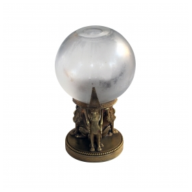 "a well-executed swedish crystal orb vase on a bronze egyptian-inspired stand; vase etched ""Orrefors"" with original foil label"