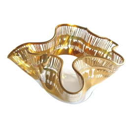 an undulating clear glass 1960's handkerchief vase with gilded perimeter band; with acid etched signature; possibly austrian