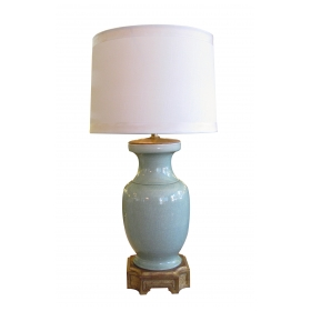 an elegant chinese celadon urn now mounted as a lamp