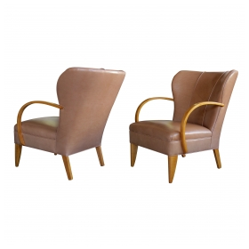 a large-scaled pair of swedish 1940's wing back chairs with bentwood arms