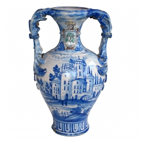 a striking continental glazed earthenware two-handled blue and white painted urn