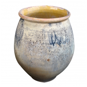 a large french earthenware confit pot with yellow-glazed interior