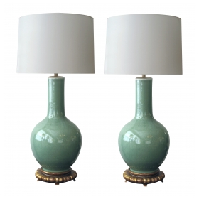 a large-scaled and good quality pair of chinese bottle-form celadon lamps on gilt wood bases